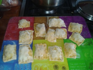 selfmade pasta squares filled with mince and capsicum (Maultaschen)